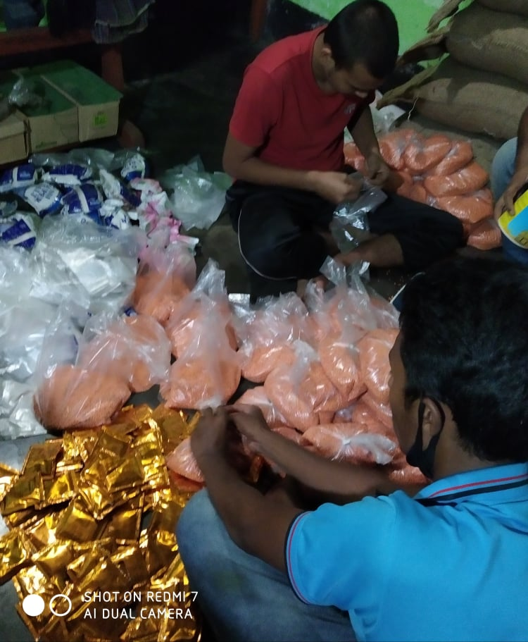 Volunteer A J Salim: Packing.