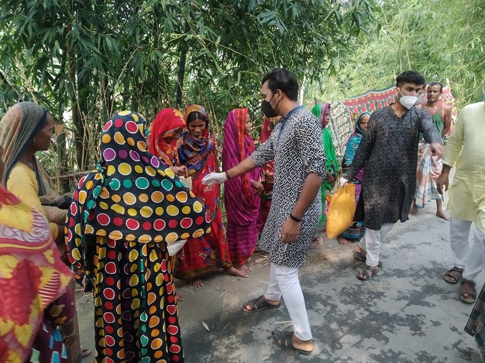 Volunteer A J Salim: Distributing.
