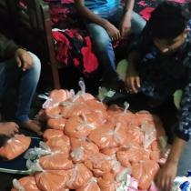 Volunteer A J Salim: Packing (lentils).